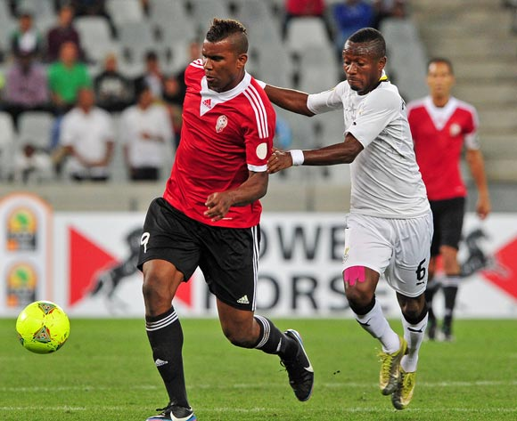 Elmutasem Abushnaf of Libya takes on Michael Akuffo of Ghana during the 2014 CAF African Nations Championships Final between Libya and Ghana at Cape Town Stadium, Cape Town on 1 February 2014