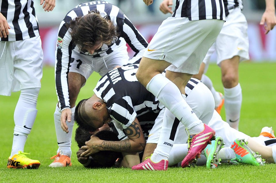Kwadwo Asamoah is mobbed by Juve players after scoring the opening goal