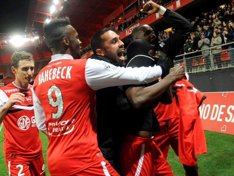 Majeed Waris mobbed by Valenciennes team-mates