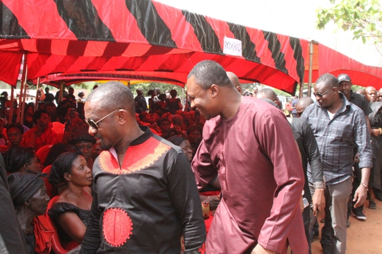 Ghana FA spokesman Ibrahim Sannie greets relatives at the funeral grounds