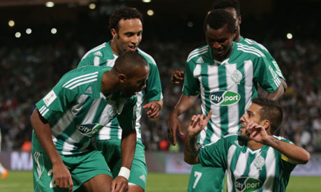 Raja Casablanca's Mohsine Moutaouali, right, celebrates with team mates after scoring his side's second goal during their semi final soccer match between Raja Casablanca and Atletico Mineiro at the Club World Cup soccer tournament in Marrakech, Morocco, Wednesday, Dec. 18, 2013(Photo: AP)