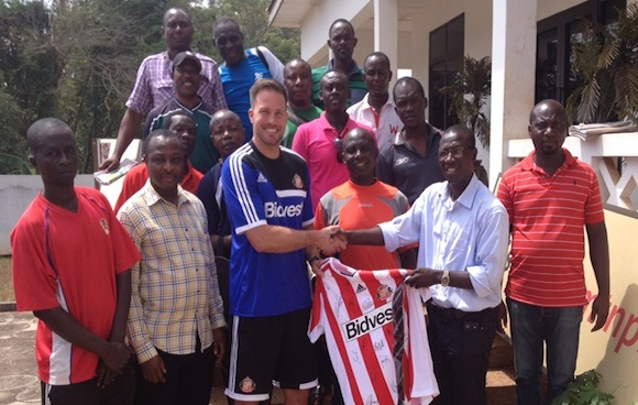 Graham Robinson and Asante Kotoko officials.