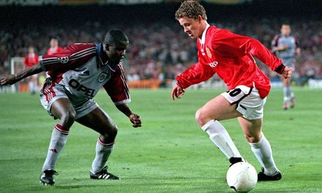 Samuel Kuffour, left, faces Ole Gunnar Solskjaer in the 1999 European Cup final won 2-1 by Manchester United. Photograph: Popperfoto/Getty Images