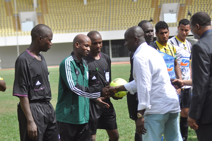 Medeama president Moses Armah exchange pleasantries with match officials