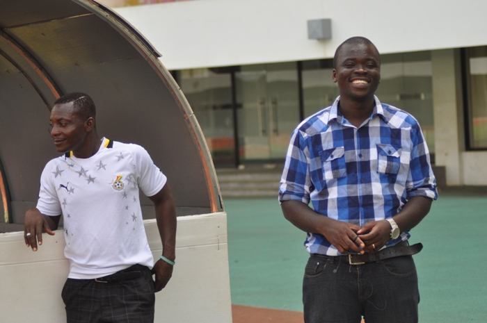 Ghana FA liaison officer Mark Addo (smiling)