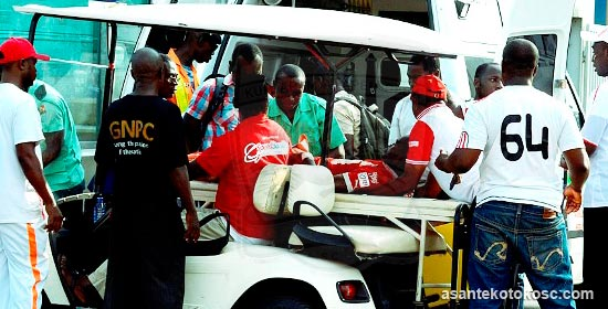 Amos Frimpong being conveyed to hospital by emergency works at the Baba Yara Stadium on Wednesday