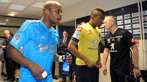 Andre and Jordan Ayew walking through the tunnel at the Stade Auguste-Bonal
