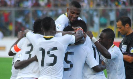 Black Stars players in goal celebration
