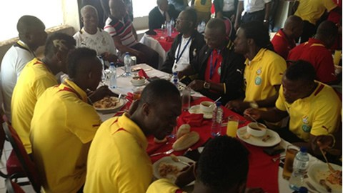 Black Stars having a meal