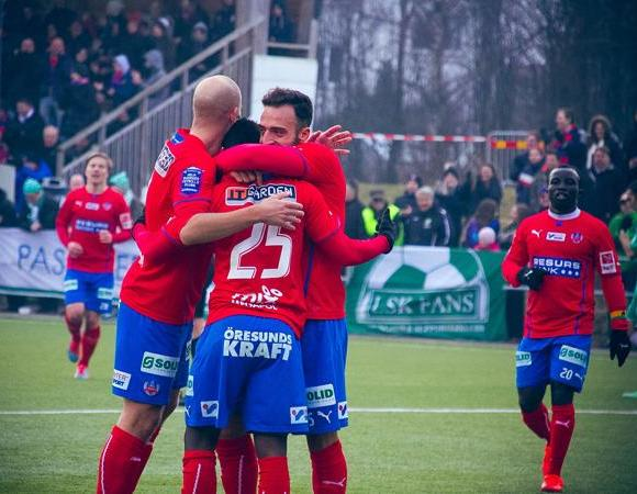 David Accam is mobbed by Helsingborg players after scoring second goal