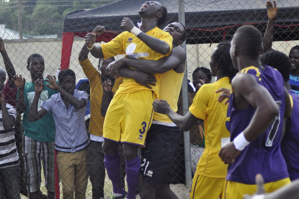 Godbless Asamoah celebrates his goal.