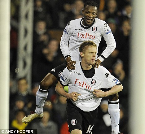 Happier days: John Pantsil (above) with former Cottagers team-mate Damien Duff