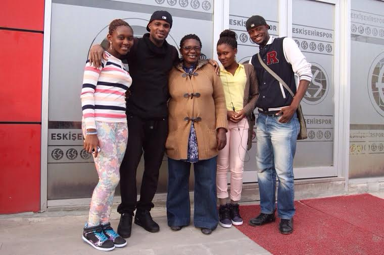 Jerry Akaminko with his family and a friend after Sunday's win