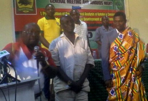 Maxwell Konadu dressed in a ceremonial kente cloth after being awarded