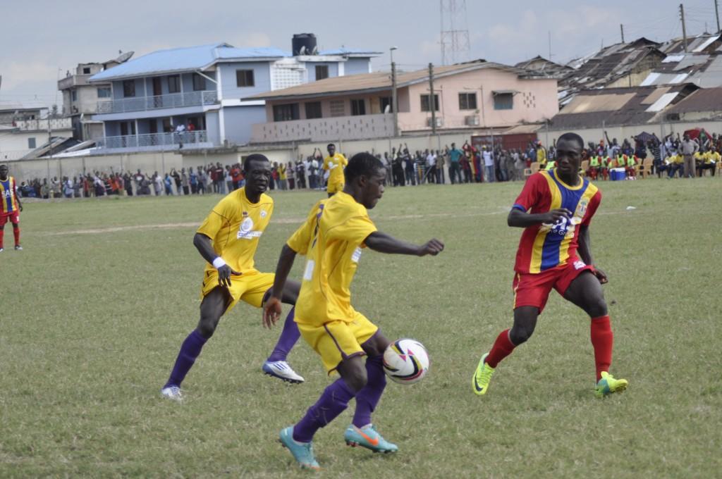 Kwame Boahene tries to sneak past Eric Kumi.