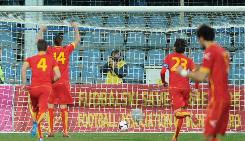 Montenegro take the lead after converting an early penalty.