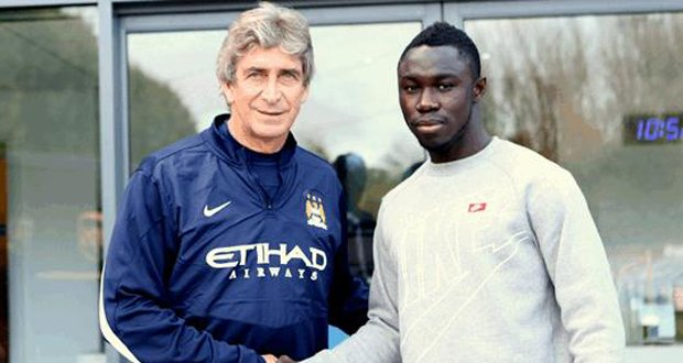 Nana Boateng with Man City manager Manuel Pellegrini during the Norway's off season