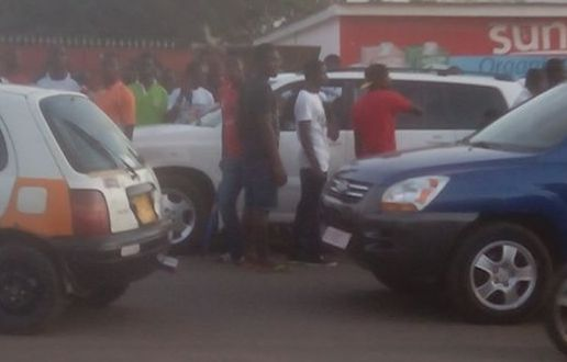 The crowd gathered by the white vehicle of Mohammed Polo after the Hearts fan was beaten up