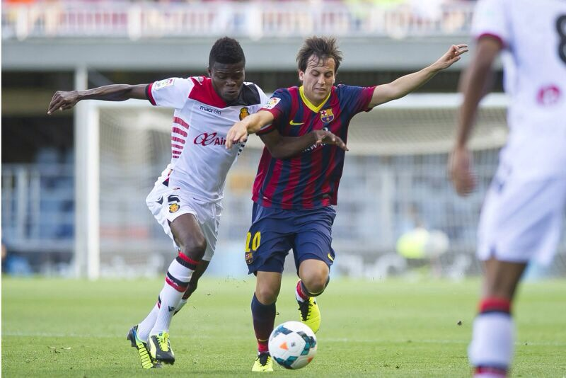 Thomas Partey, left in a challenge with a Barcelona player, is confident Real Mallorca will not be relegated