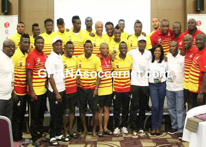 Officials of Unibank with the Black Stars team