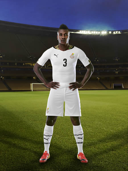Asamoah Gyan modelling in the Black Stars World Cup jersey