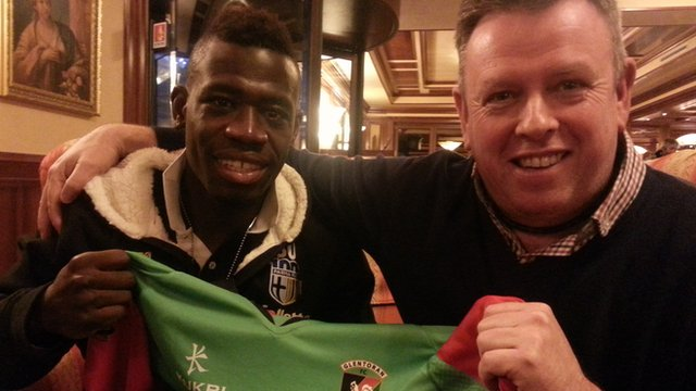 Sam Robinson (right) pictured with Acquah on a recent trip to see him play for Parma in Serie A
