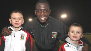 Acquah, then 15, bonded with Robinson's two sons Jack (left, then aged eight) and Jordi (right, then five)