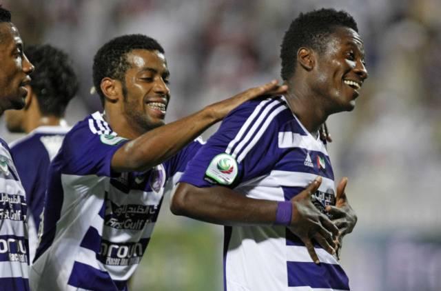 Asamoah Gyan celebrates a goal