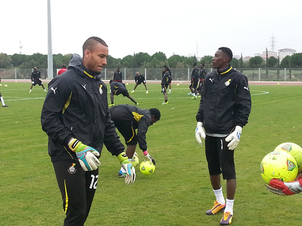 Goalkeepers going through their training routines