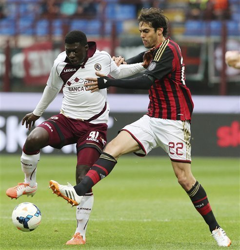 AC Milan Brazilian forward Kaka, right, challenges for the ball with Livorno midfielder Joseph Duncan, of Ghana, during the Serie A soccer match between AC Milan and Livorno at the San Siro stadium in Milan, Italy