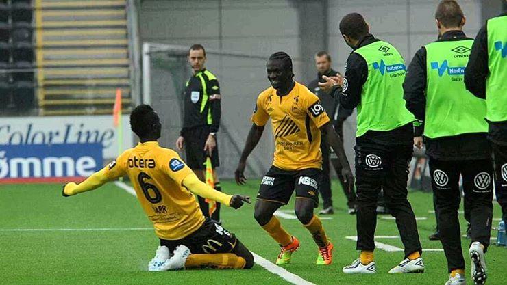 flamboyant Asante celebrates goal with Nigerian Samuel