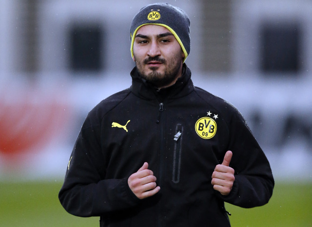 Dortmund's Ilkay Gundogan warms up during a training session one day ahead the Champions League group F soccer match between Borussia Dortmund and Arsenal FC in Dortmund, Germany, Tuesday, Nov. 5, 2013. (AP Photo/Frank Augstein)