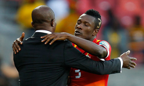 Ghana captain Asamoah Gyan fights his coach Kwesi Appiah for SWAG Sports Personality of the Year award