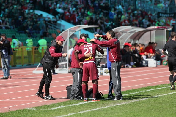Mubarak Wakaso being treated on the sidelines before being taken off