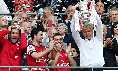 Trophy-starved Arsenal fans in Ghana went gay on Saturday when Aaron Ramsey scored an extra-time winner to defeat Hull City in the FA Cup final and end the Gunners' nine-year trophy drought.