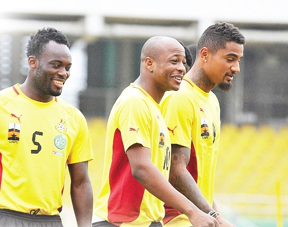 Michael Essien (left), Andre Ayew and Kevin-Prince Boateng (right).