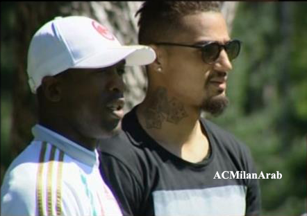 Kevin-Prince Boateng and AC Milan coach Clarence Seedorf.