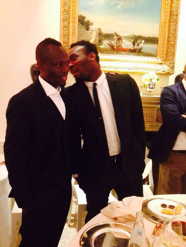 Emmanuel Agyemang-Badu, left, interacts with Essien during the event