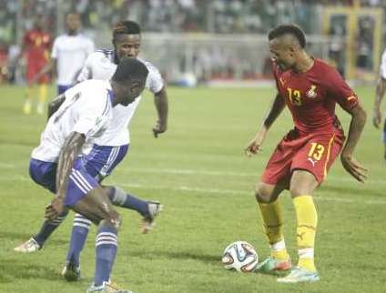 Jordan Ayew controlling the ball amidst challenges from opponents
