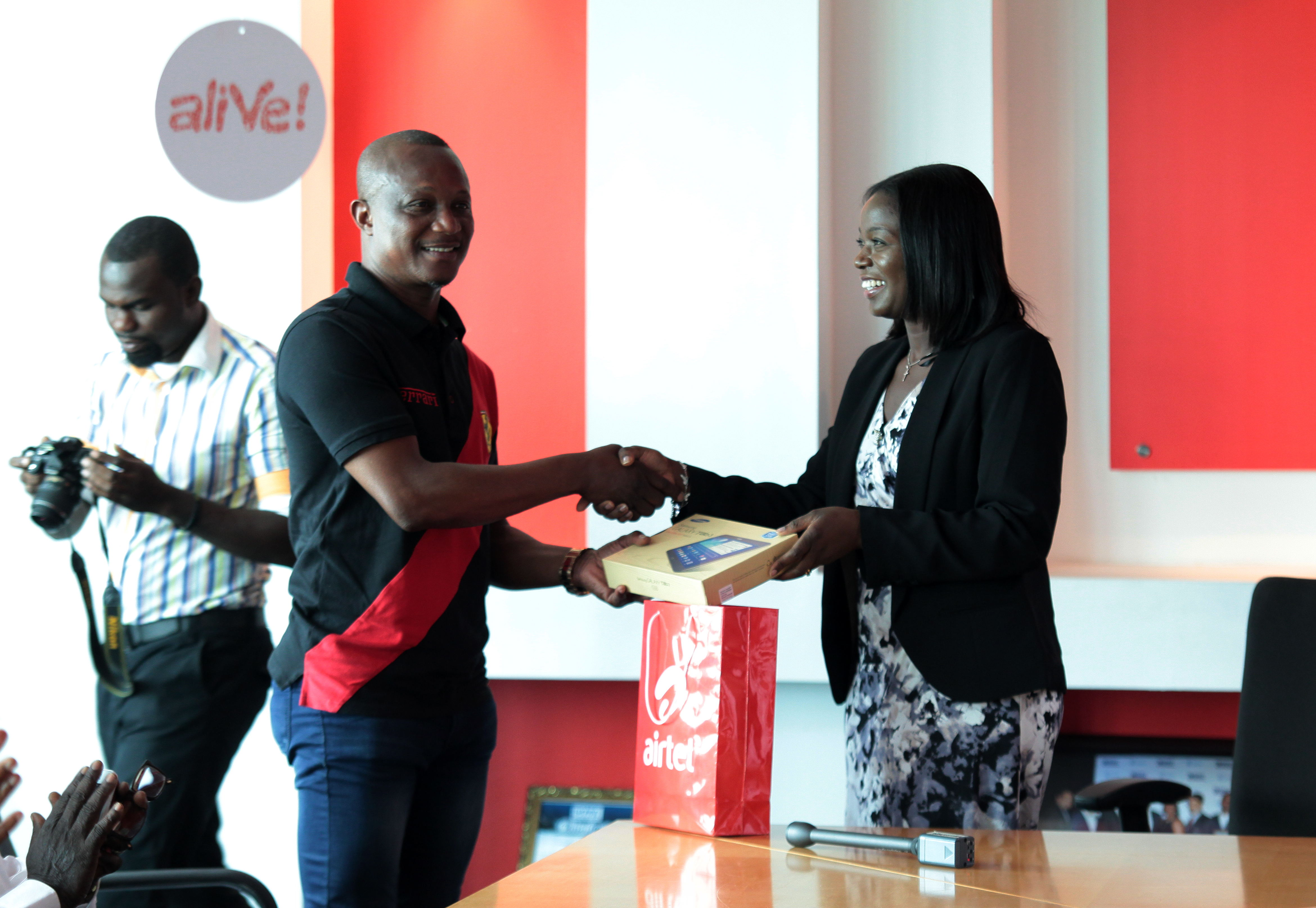 Coach receives a one year's Airtel data subscription on a Samsung tablet from Airtel Ghana MD