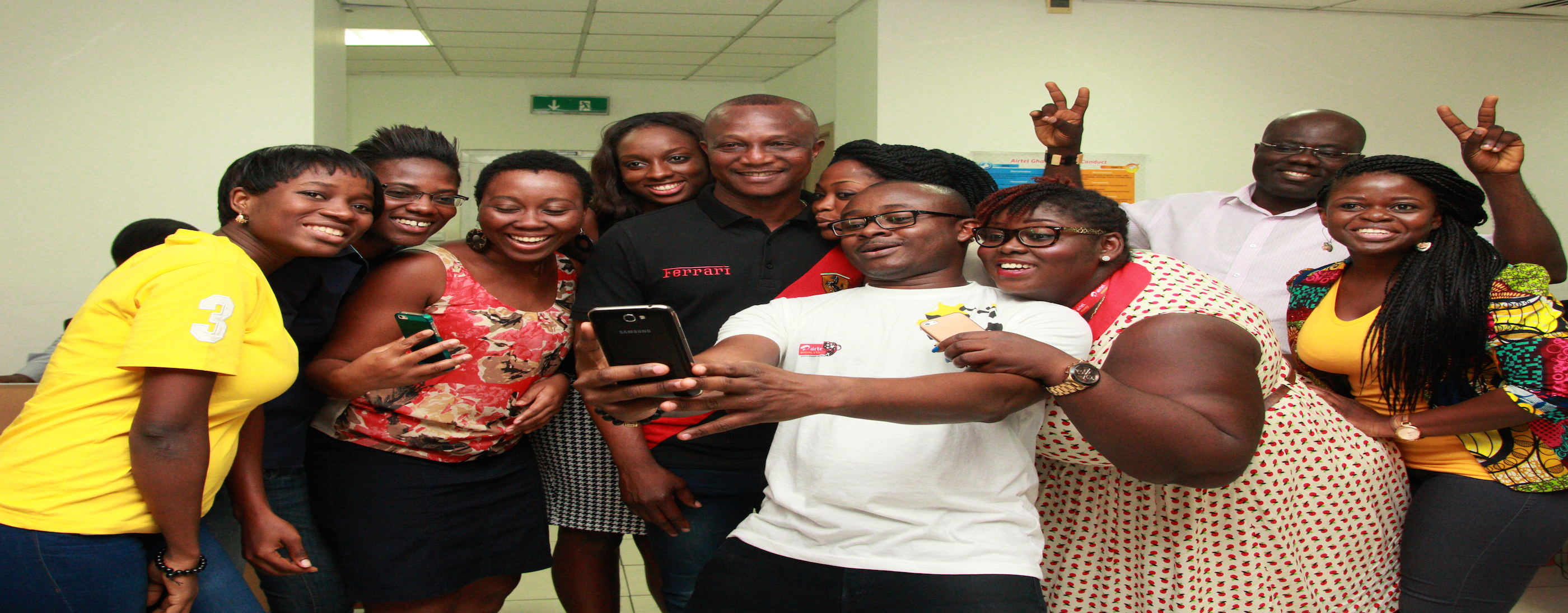Staff of Airtel's Marketing Department take a selfie with Coach Kwesi Appiah