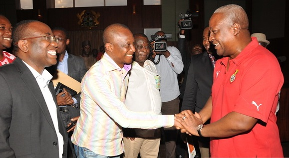 President John Mahama in a handshake with coach Kwesi Appiah