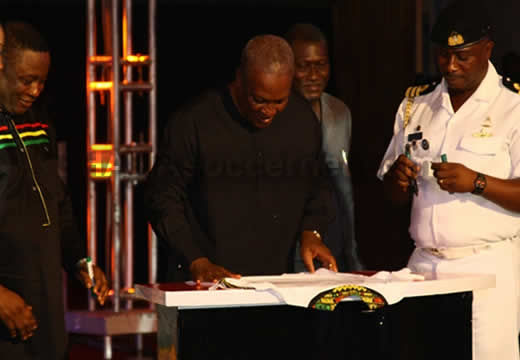 President Mahama signing the replica jerseys which were auctioned on the night