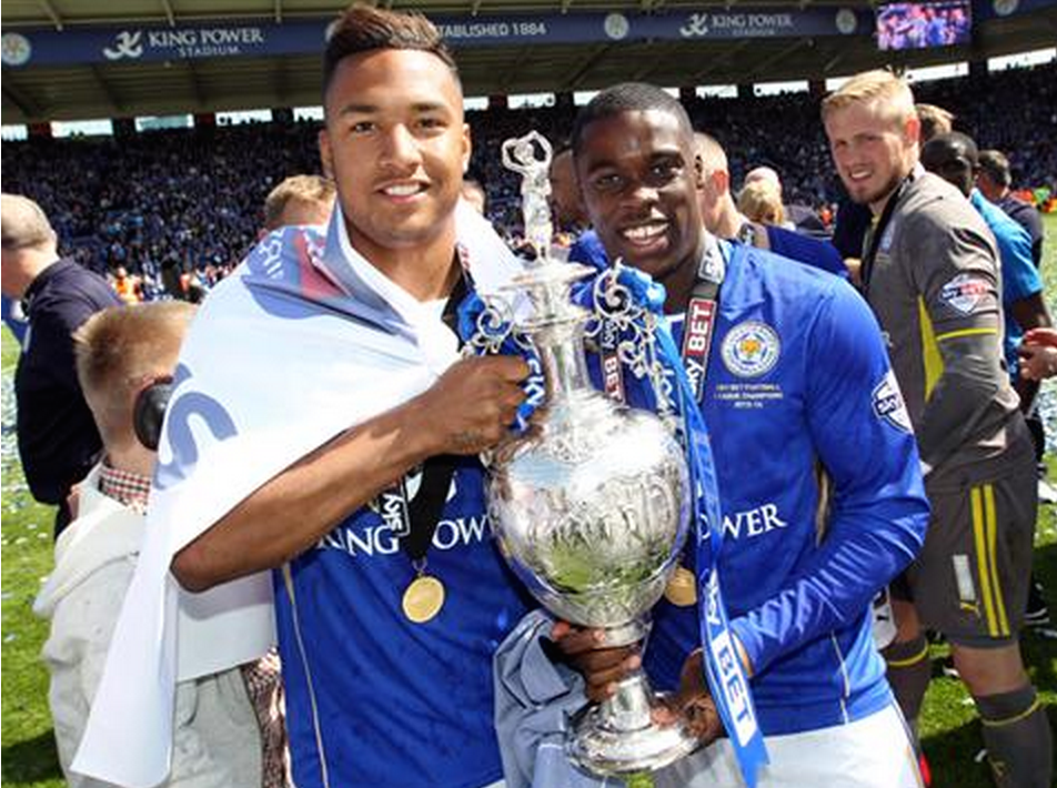 Liam Moore and Jeffrey Schlupp with Championship trophy.