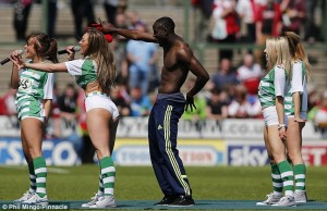 Fans watched on in shock as topless Middlesbrough winger Albert Adomah interrupted the girl band 'Viva Pitch' during their performance in the Yeovil Town post-match celebrations on the final day of the season.