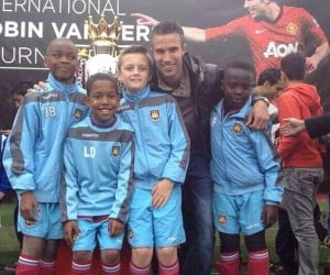 Meeting the stars: Omari, pictured right with Robin van Persie, has been at West Ham since the age of 5