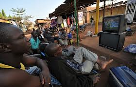 Fans watching football in Africa.