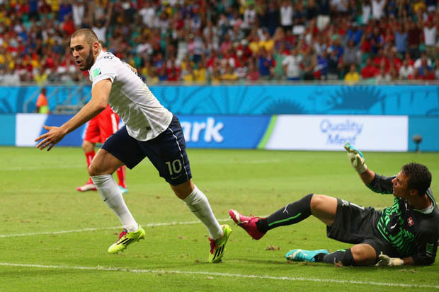 Karim Benzema celebrating France's fourth goal.