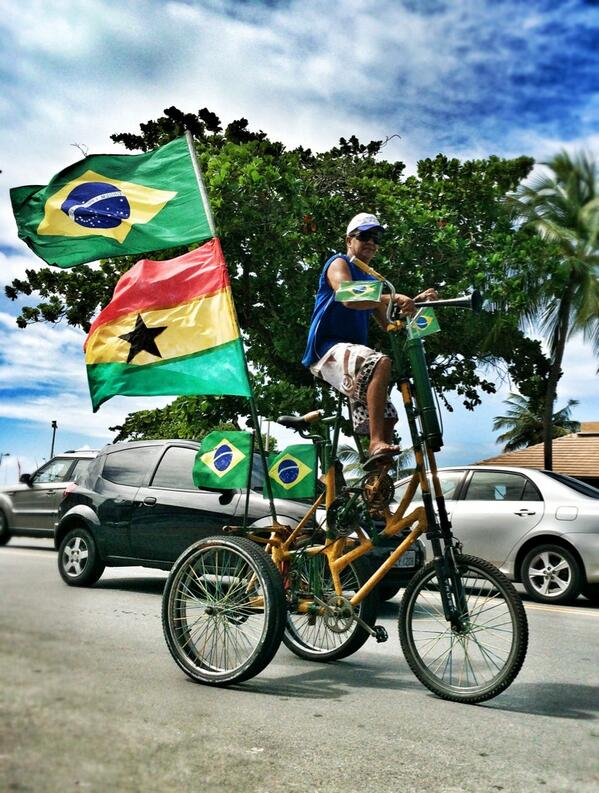 Cyclist shows support for Ghana at the World Cup.