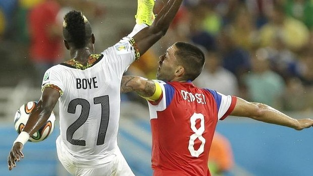Ghana defender John Boye challenging USA's Clint Dempsey for the ball
